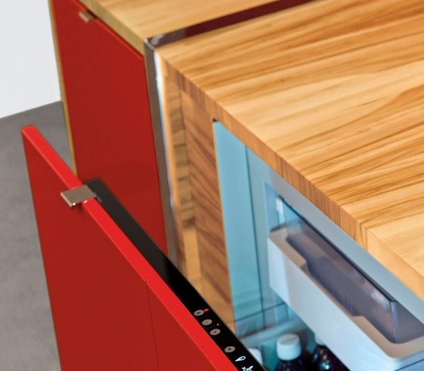 Cool drawer is built into the three high credenzas